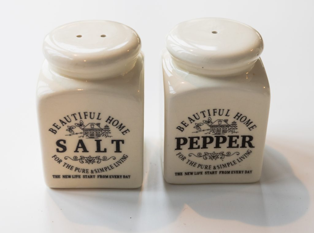 Ceramic Salt & Pepper Shaker fewer holes for pepper than for salt